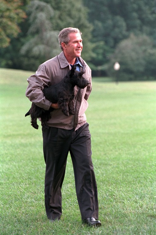 President George W. Bush carries Barney to the South Portico of the White House Monday, Sept. 3, 2001, after disembarking Marine One. Photo by Tina Hager, Courtesy of the George W. Bush Presidential Library